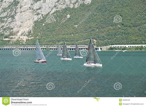 sailboats used in competitive sailing sailboat on the como lake editorial photo image 44260156
