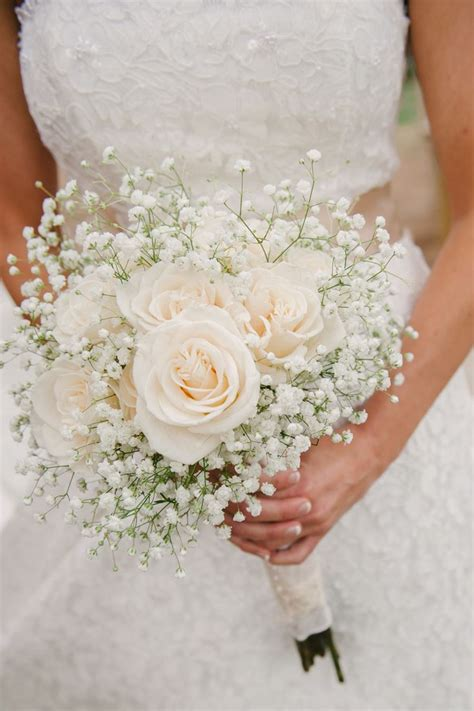 Wedding Bridal Bouquets by A Simple Bouquet Of Ivory Roses And Baby S Breath Photo