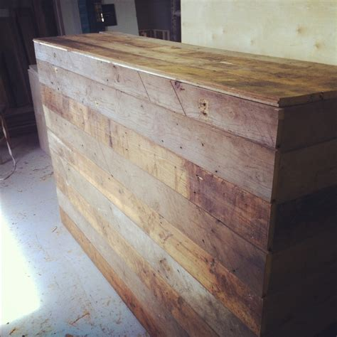 reclaimed wood front desk front desk front and sides covered with reclaimed wood