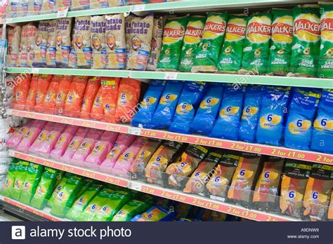 Shelf Of Potato Chips by Bags Of Crisps And Potato Snacks On A Supermarket Shelf