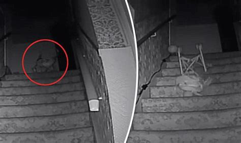 black monk filmed pushing pushchair  stairs  ghost