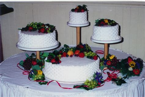 Cascading Stand Wedding Cake with Fruit and Flowers