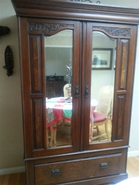 antique armoire wardrobe  beveled glass