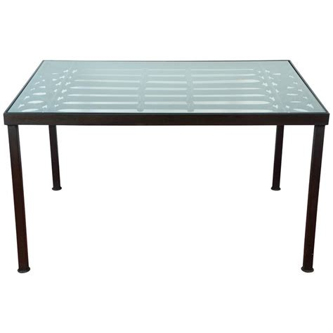 wrought iron and glass indoor outdoor dining table for