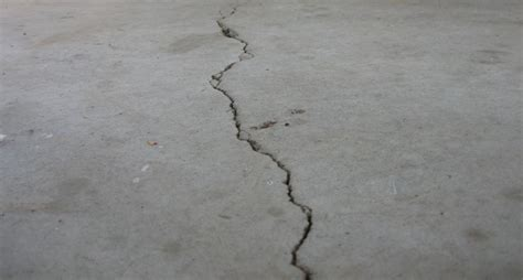 how to repair cracks and pitting in your garage floor