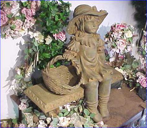 little girl sitting on bench statue bed breakfast sainte genevieve mo southern hotel gift shop