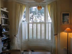 Window Treatments For A Bow Window changing curtains