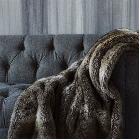 faux fur throws for sofas chinchilla faux fur throw and tufted grey sofa urban