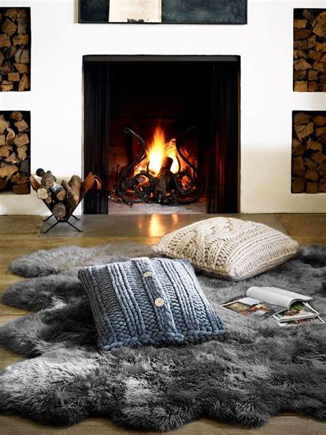 skin rug fireplace 17 best ideas about sheepskin rug on white sheepskin rug white faux fur rug and