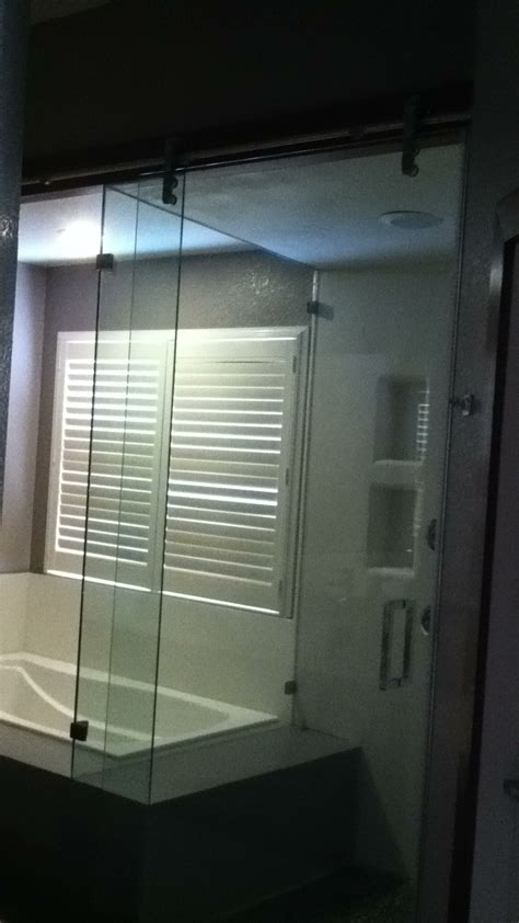 glass shower door slides like barn door for the home