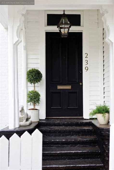 White house with black front door cottage home exterior atlanta homes amp lifestyles