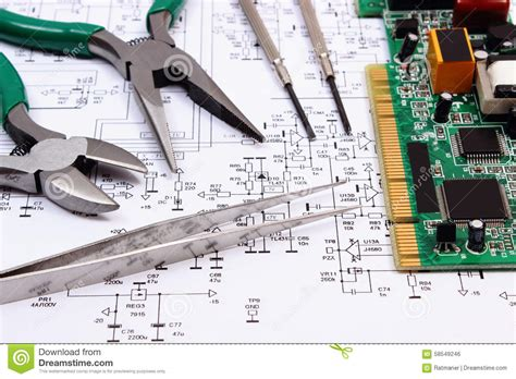 ic layout contractor engineer printed circuit board and precision tools on diagram of