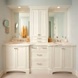 Storage cabinet and white vanity design at traditional bathroom