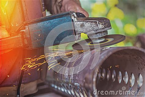 worker cutting steel pipe using metal stock photo 380191102 worker steel pipe with grinder stock photo image 61068873