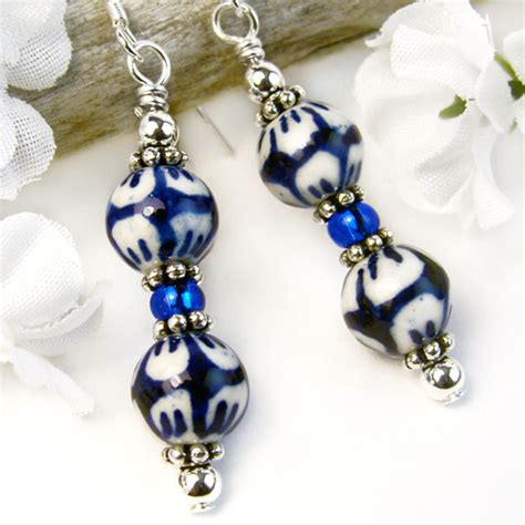 Handmade Beaded Earrings Designs - blue and white earrings flower petals design ceramic