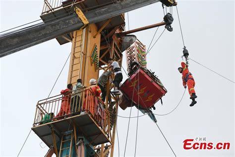 theme park fails four tourists suspended in air as amusement park ride