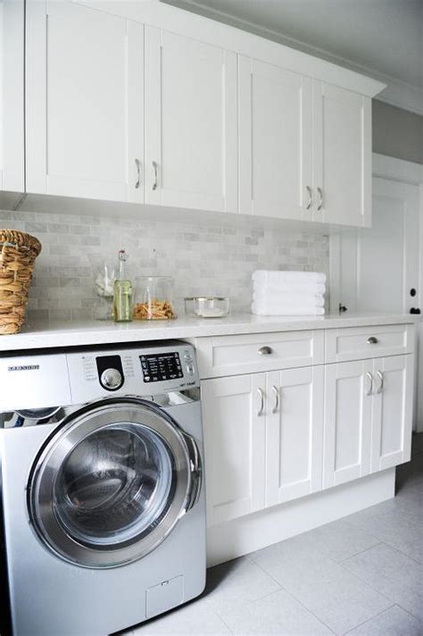 Gray Laundry Room Features White Shaker Cabinets Paired