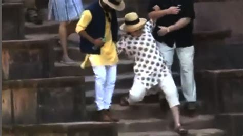 is she okay hillary clinton slips down the stairs while hillary clinton tumbles twice walking down stairs on trip