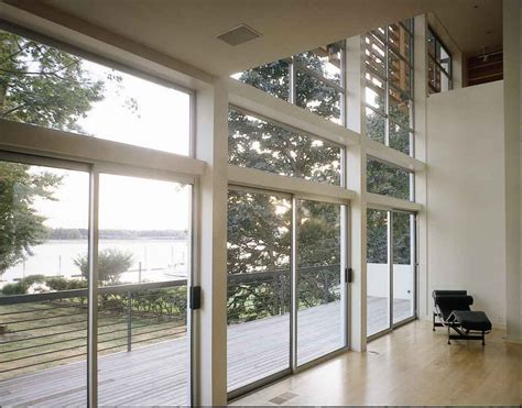 Modern Exterior Sliding Glass Doors Exterior Sliding Glass Door For Modern Riverside House Design With High Ceiling And Balcony