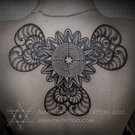 esoteric tattoo a labyrinth hearts and floral elements merge to create