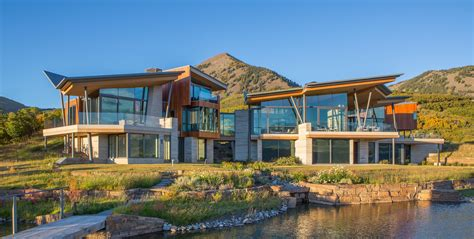 Beach Style Homes by A 32 5 Million Glass House On The Edge Of A Cliff In The