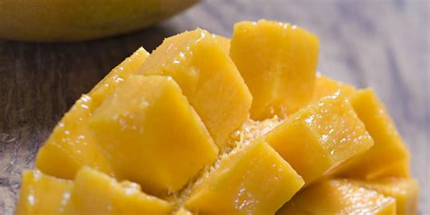 best way to cut a mango once and for all the best way to cut a mango huffpost