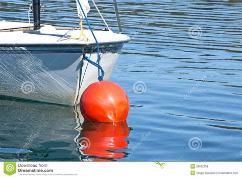 boat on buoy boat and red buoy lake reflection royalty free stock