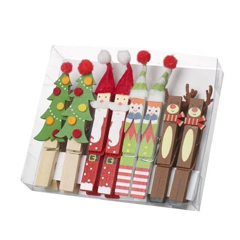 festive wooden decorated pegs set of 6 christmas decorations