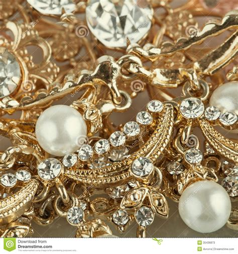 wallpaper of gold earring set of gold jewelry background stock image image 35436873