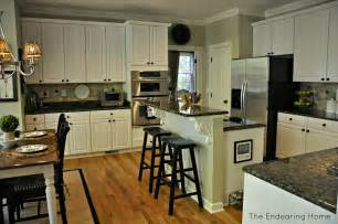 Update White Kitchen Cabinets by Baltic Brown Granite White Cabinets Backsplash Ideas