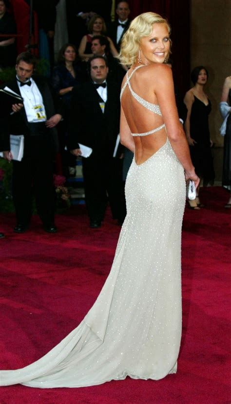 Charlize Therons White Poofy Number by Top 10 Oscar Dresses Of All Time From Hepburn To