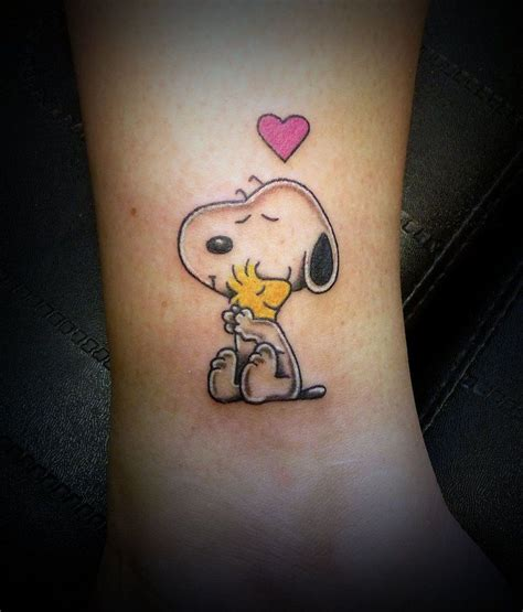 snoopy and woodstock tattoo snoopy on snoopy pelt