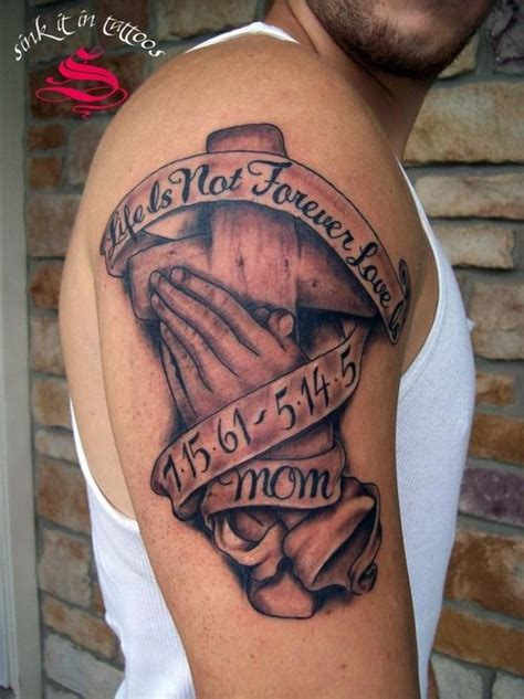tattoo cross hands memorial cross and praying hands tattoo on biceps madre