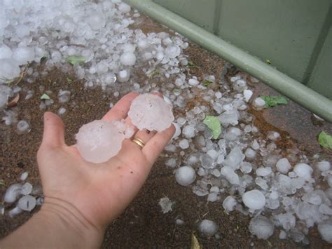 hail definition of hail by the free dictionary file perth hail size compared to hand jpg wikimedia commons