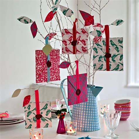 tabletop tree hung with envelope gifts country christmas