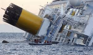 costa concordia wreck which saw deaths of 32 when it sank is towed to last berth daily mail