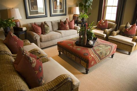Spacious Living Room In Earth Tones And Splashes Of Red Living Room Ottoman Coffee Table
