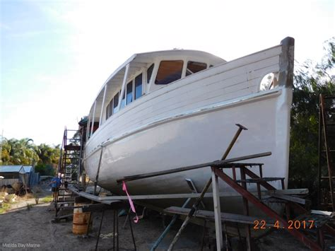 catamaran unfinished project custom ex commercial trawler style expedition cruiser