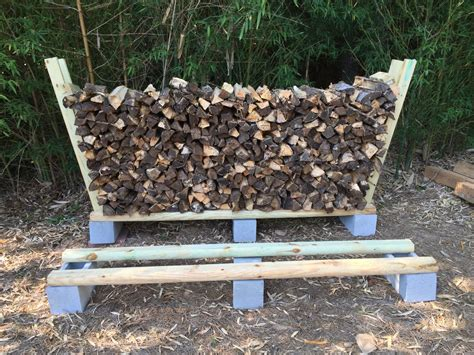diy firewood rack cinder blocks storing the split firewood steve s place