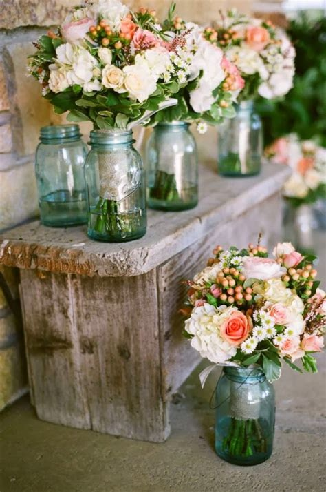 blue mason jars for tree stumps and tables but different floral arrangement on tables ideas