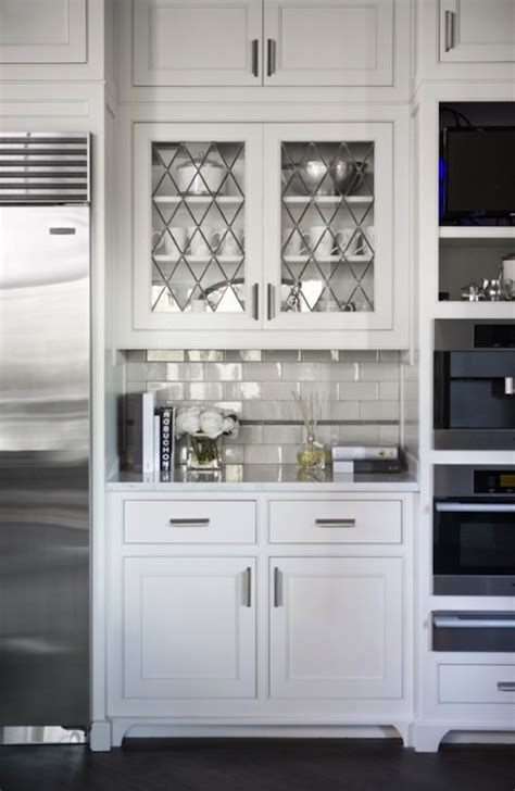 white cabinet with glass doors leaded glass cabinet doors transitional kitchen