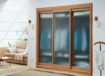 Coloured Glass Wardrobe Doors by Glass Sliding Door Wardrobes Wardrobe Magic Fitted