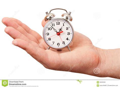 alarm clock   mans hand stock photo image