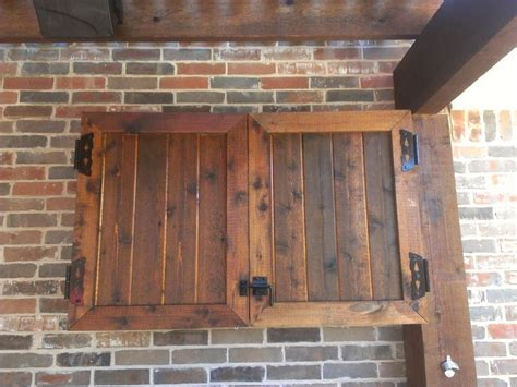 rustic wooden outdoor tv cabinet with bi fold door cabinet