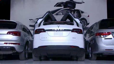 tesla model x falcon wing doors in parking