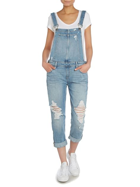 Overal Ripped Light overall ripped denim dungarees in blue lyst
