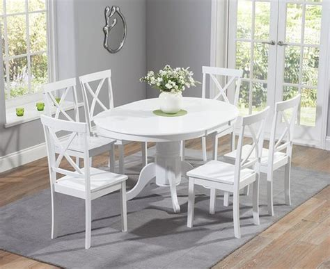 White Pedestal Dining Table Set Buy The Epsom White Pedestal Extending Dining Table Set With Chairs At Oak Furniture Superstore