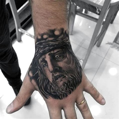 christian tattoo on hand 20 jesus hand tattoo designs for men christ ink ideas