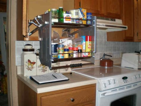 kitchen cabinet pull down shelves pull down shelf kitchen pinterest