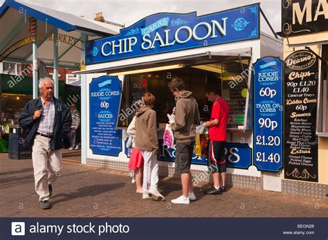 great yarmouth indoor market great yarmouth united kingdom people eating chips from a chip stall carrs chip saloon